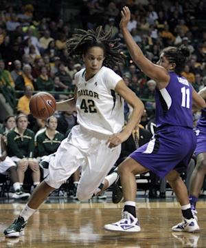 Baylor center Brittney Griner (42) drives around Kansas State's Chantay Caron (11) during the second half of an NCAA women's college basketball game Saturday, Jan. 21, 2012, in Waco, Texas. Griner had a game-high 22 points as Baylor won 76-41. (AP Photo/Tony Gutierrez)