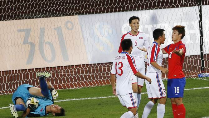 North Korea's captain Jang Song Hyok and South Korea's Lee Jong-ho confront each other during the men's football gold medal match at Munhak Stadium during the 17th Asian Games in Incheon