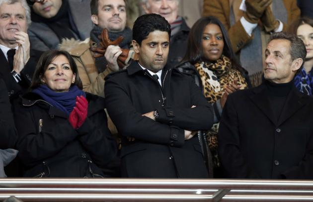 Deputy Mayor Anne Hidalgo, Nasser al-Khelaifi, Paris Saint Germain's club president and former French President Nicolas Sarkozy attend the French Ligue 1 soccer match between Paris Saint-Germain a