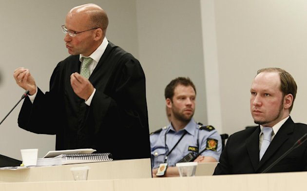 Defense lawyer Geir Lipepstad, left, gives his final statement in court during the trial of terror charged Anders Behring Breivik, right, in Oslo, Friday, 22 June, 2012. On the last day of his trial, Anders Behring Breivik's defense lawyers on Friday tried to cast the confessed mass killer as a political militant motivated by an extreme right-wing ideology rather than a delusional madman who killed 77 people for the sake of killing. (AP Photo/Heiko Junge/pool)