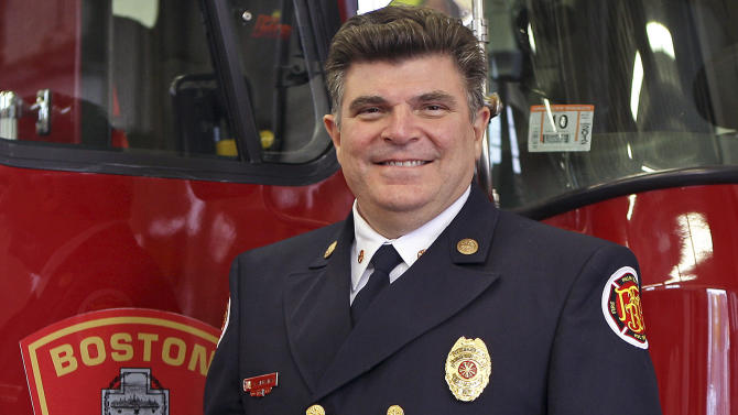 In this Nov. 16, 2011 photo, Boston Fire Chief Steve Abraira poses for a photo at a fire station in Boston. In a letter dated Monday, June 3, 2013, Abraira said he is resigning effecting on Friday, saying public criticism from his deputies for the way he responded to the marathon bombings has made it impossible for him to do his job. Thirteen deputies had complained in a letter to Mayor Tom Menino that Abraira's failure to take command of the Boston Marathon bombing scene was indefensible and part of a pattern of shirking leadership. (AP Photo/Boston Herald, Mark Garfinkel) BOSTON GLOBE OUT. METRO BOSTON NEWSPAPER OUT. MAGS OUT.