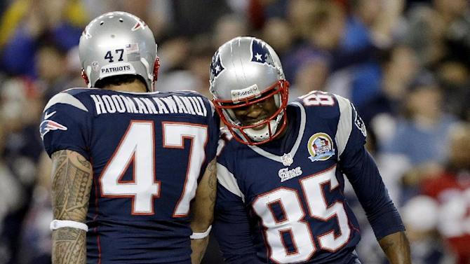 New England Patriots wide receiver Brandon Lloyd (85) celebrates his touchdown catch with tight end Michael Hoomanawanui (47) during the first quarter of an NFL football game against the Houston Texans in Foxborough, Mass., Monday, Dec. 10, 2012. (AP Photo/Elise Amendola)