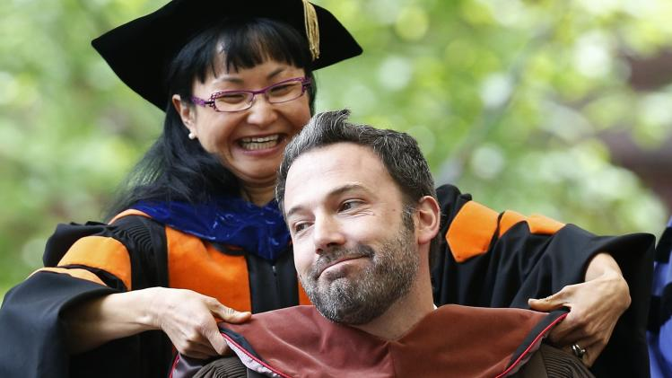 Actor and director Ben Affleck reacts as he receives an honorary degree at Brown University's commencement in Providence, R.I., Sunday, May 26, 2013. (AP Photo/Michael Dwyer)