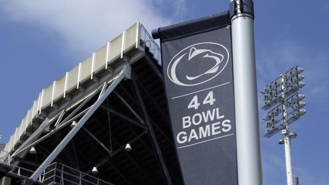 A banner celebrating the 44 bowl games that the Penn State football team has played in hangs outside of Beaver Stadium on the Penn State University main campus in State College, Pa., Monday, July 23, 2012. Penn State football was all but leveled Monday by an NCAA ruling that wiped away 14 years of coach Joe Paterno's victories and imposed a mountain of fines and penalties, crippling a program whose pedophile assistant coach spent uncounted years molesting children, sometimes on university property. (AP Photo/Gene J. Puskar)