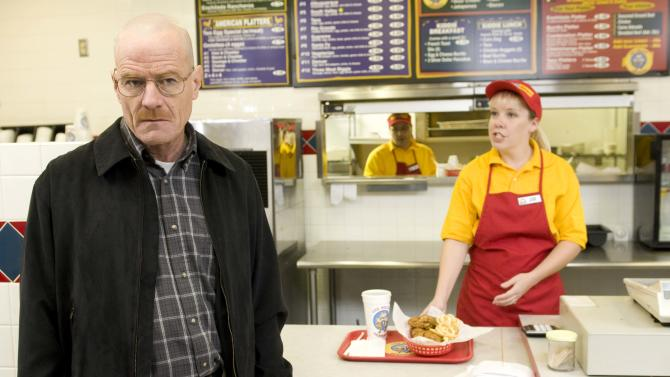 "This image released by AMC shows Bryan Cranston as Walter White at the fictional restaurant ""Los Pollos Hermanos"" in a scene from season 2 of the AMC series ""Breaking Bad.""  A Twisters burrito restaurant in Albuquerque that serves as the location for the restaurant has become an international tourist attraction as people come from all over the world to see the spot where a fictional drug trafficker runs his organization. (AP Photo/AMC)"