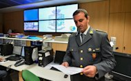 An officer of the Guardia di Finanzia reads a report in a regional command centre on November 20, 2012 in Rome. Police man the phones 24/7, receiving a flood of reports from citizens against tax dodgers -- from landlords failing to declare their rental income to shopkeepers and waiters failing to provide receipts