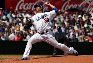 Los Angeles Dodgers' Hyun-Jin Ryu throws a pitch against Arizona Diamondbacks during their Major League Baseball game in Sydney