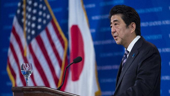 "Japanese Prime Minister Shinzo Abe speaks at Columbia University's year-round ""World Leaders Forum"" series in New York Monday, Sept. 22, 2014. (AP Photo/Craig Ruttle)"