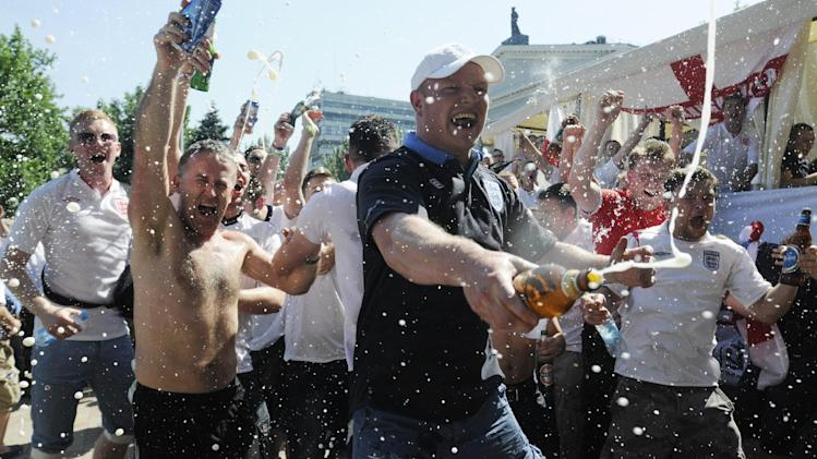 English soccer fans spray beer before the group D match between England and France during the Euro 2012 soccer championship in Donetsk, Ukraine, Ukraine, Monday, June 11, 2012. (AP Photo/Sergei Chuzavkov)