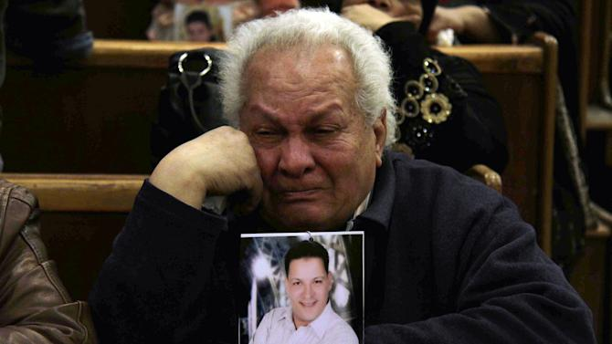 UPDATES DEATH TOLL - Families of the victims of the Ultras Al-Ahli football supporters who died last year in soccer violence, react in court after the issuance of the death penalty for 21 accused in the Port Said incident, in Cairo, Egypt, Saturday, Jan. 26, 2013. Egyptian security officials say military to deploy in Port Said after 38 people including a senior police officer and a policeman were shot dead in the Mediterranean city of Port Said after a judge sentenced 21 people to death in connection to one of the world's deadliest incidents of soccer violence. (AP Photo/Ahmed Abd El-Latef, Shorouk Newspaper)   EGYPT OUT