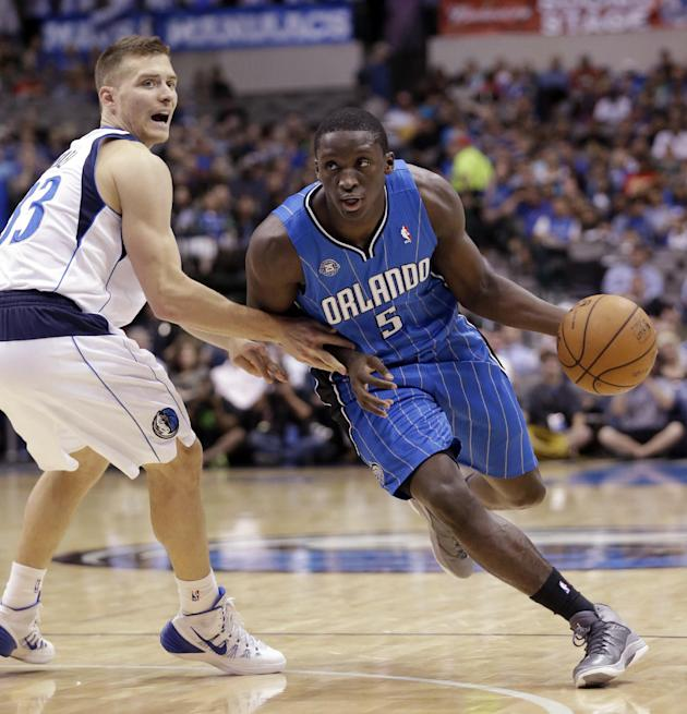 Orlando Magic shooting guard Victor Oladipo (5) drives past Dallas Mavericks point guard Gal Mekel (33) of Israel during the first half of an NBA preseason basketball game in Dallas,  Monday, Oct. 14,