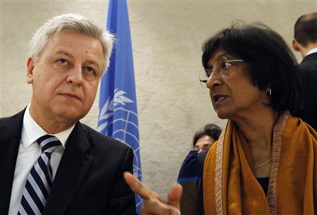 U.N. High Commissioner for Human Rights Navi Pillay (R) talks to Remigiusz Henczel, President of the Human Rights Council before the 22nd session of the Human Rights Council at the United Nations in Geneva February 25, 2013. REUTERS/Denis Balibouse