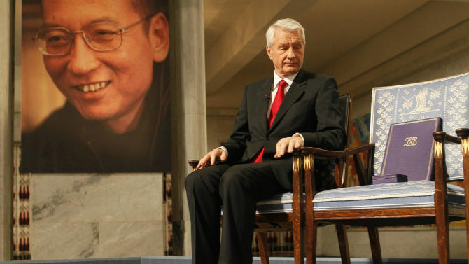 FILE - In this Friday Dec. 10, 2010 file photo, Norwegian Nobel Committee Chairman Thorbjoern Jagland sits next to the Nobel diploma and Nobel medal placed on the empty chair during the ceremony in Oslo City Hall to honor Nobel Peace Prize winner, jailed Chinese dissident Liu Xiaobo. Mainly associated with conflict resolution, foreign assistance and cozy Scandinavian prosperity, Norway makes an odd target for China's ire. Yet for three years, Beijing has frozen relations with Oslo since a committee appointed by the Norwegian parliament awarded the 2010 Nobel Peace Prize to imprisoned Chinese dissident Liu Xiaobo, deeply embarrassing China's leaders. (AP Photo Heiko Junge, Pool, File)