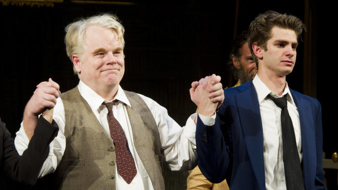 "FILE - In this March 15, 2012 file photo, actors Philip Seymour Hoffman, left, and Andrew Garfield appear at the curtain call for the opening night performance of the Broadway revival of Arthur Miller's ""Death of A Salesman"" in New York. The Tony Awards will be held on June 10 and broadcast live on CBS. (AP Photo/Charles Sykes, file)"