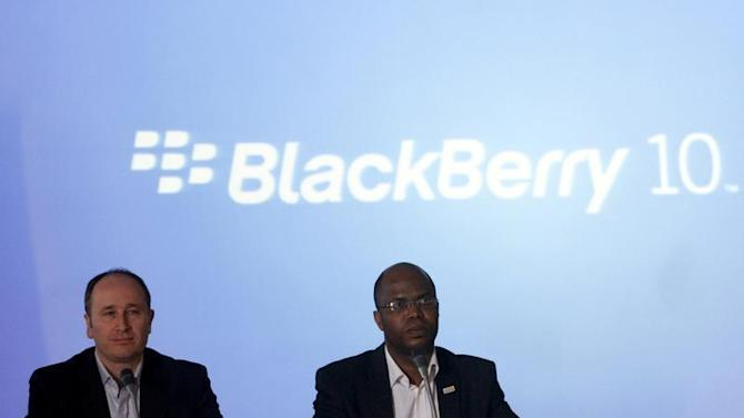BlackBerry's Senior Director for Product Management Roger Enright sits with Uzo Eziukwu, CEO of Parkway Projects, during the launch of the new BB Z10 smartphone in Lagos