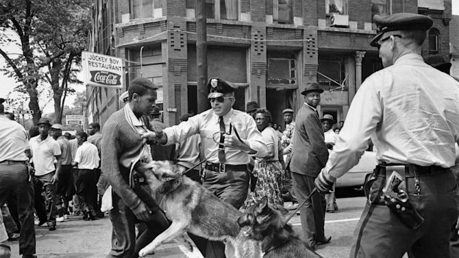 FILE - In this May 3, 1963 file photo, a 17-year-old civil rights demonstrator, defying an anti-parade ordinance of Birmingham, Ala., is attacked by a police dog. 1963 was a year of revolution in race relations in the United States. (AP Photo/Bill Hudson, File)
