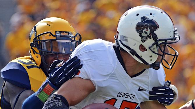 Oklahoma St faces K-State after 1st loss