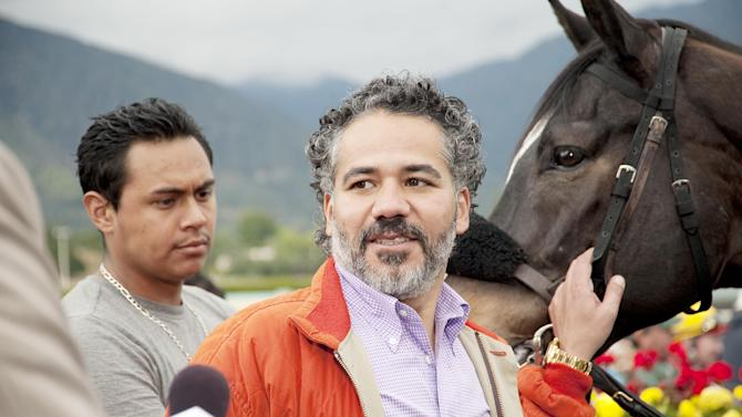"""In this undated image provided by HBO, John Ortiz appears in a scene from the HBO original series """"Luck."""" The sport of horse racing is determined to endure the inevitable deaths of its injury-prone animals. But Hollywood has proved it lacks the stomach for it. The HBO TV channel ended the racing series """"Luck"""" after three horses used in the realistic production were injured and euthanized over a period stretching from 2010 to last week. (AP Photo/HBO, Gusmano Cesaretti)"""