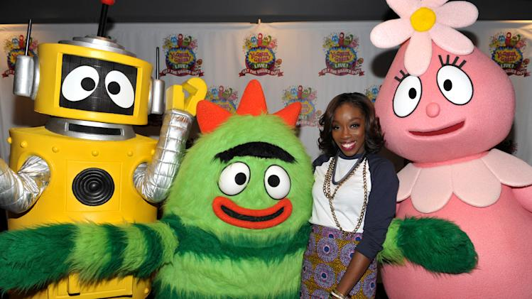 Estelle Swaray, 2nd from right, poses with Plex, Brobee and Foofa at Yo Gabba Gabba! Live!: Get The Sillies Out! 50+ city tour kick-off performance on Thanksgiving weekend at Nokia Theatre L.A. Live on Friday Nov. 23, 2012 in Los Angeles. (Photo by John Shearer/Invision for GabbaCaDabra, LLC./AP Images)