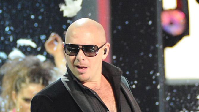 Pitbull performs onstage at the 13th Annual Latin Grammy Awards at Mandalay Bay on Thursday, Nov. 15, 2012, in Las Vegas. (Photo by Al Powers/Powers Imagery/Invision/AP)