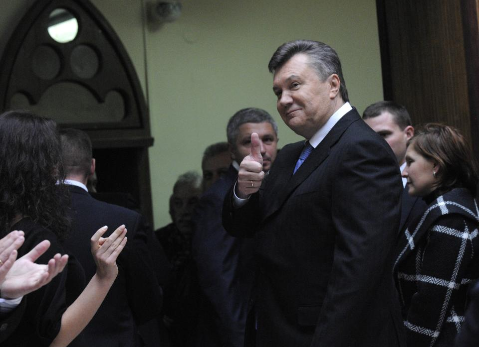 Ukrainian President Viktor Yanukovich leaves a polling station after voting  for parliamentary elections in Kiev, Ukraine, Sunday, Oct. 28, 2012. (AP Photo/Sergei Chuzavkov)