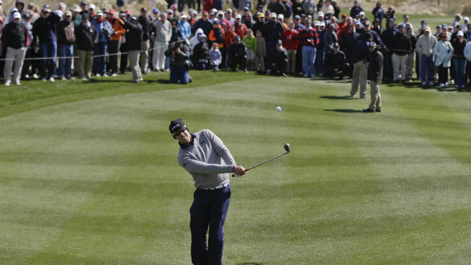 Hunter Mahan chips onto the fourth green in the final round of play against Matt Kuchar during the Match Play Championship golf tournament, Sunday, Feb. 24, 2013, in Marana, Ariz. (AP Photo/Ted S. Warren)