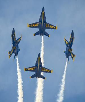 FILE - In this Saturday, March 23, 2013 file photo provided by the Florida Keys News Bureau, the U.S. Navy's Blue Angels perform their precision aerobatics over the Florida Keys during the Southernmost Air Spectacular at Naval Air Station Key West, in Key West, Fla. The commander of Naval air forces announced on Tuesday, April 9, 2013 that the U.S. Navy has canceled the remainder of the elite Blue Angels demonstration team's 2013 season because of federal cuts. (AP Photo/Florida Keys News Bureau, Rob O'Neal, File)