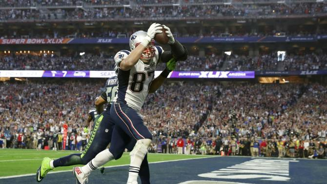 New England Patriots tight end Gronkowski catches a second quarter touchdown pass against Seattle Seahawks outside linebacker Wright during the NFL Super Bowl XLIX football game in Glendale