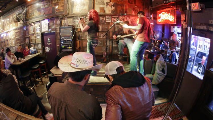 This Jan. 15, 2014 photo shows Tootsie's Orchid Lounge on Lower Broadway in Nashville, Tenn. Most of the bars on lower Broadway are free from cover charges, although it's always good to tip the band when they pass the bucket around. (AP Photo/Mark Humphrey)