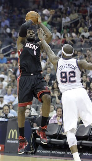 Furious flurry by James gives Heat win over Nets