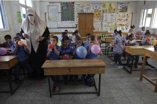 Palestinian students blow balloons on the first day of the school year at a U.N.-run school in the central Gaza Strip