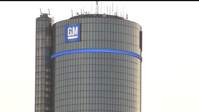 MoneyWatch: GM death toll at 50; Stock exchange open despite blizzard