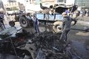 Municipality workers clean debris at the site of a bomb attack in Kerbala
