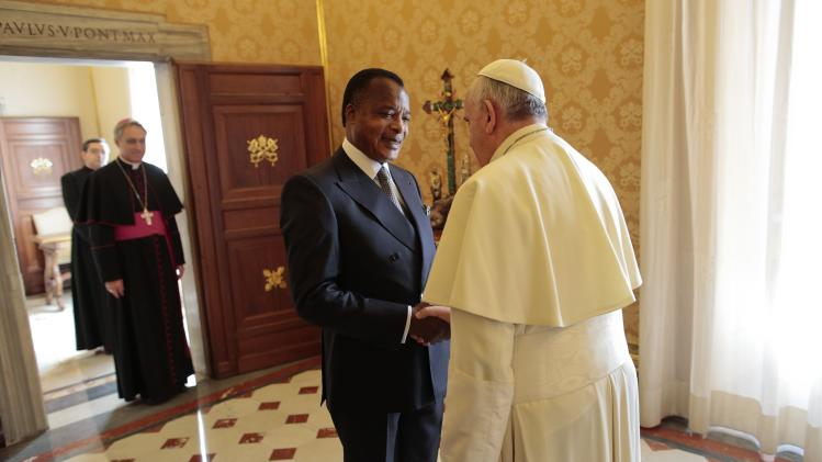 Pope Francis welcomes Congo Republic President Denis Sassou-Nguesso as he arrives for a private audience at the Vatican