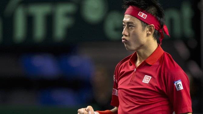 Kei Nishikori celebrates his win against Vasek Pospisil during their Davis Cup tennis match in Vancouver