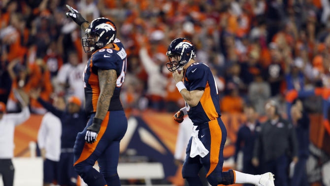 Denver Broncos quarterback Peyton Manning, right, runs to the end zone after throwing his 510th career touchdown during the first half of an NFL football game against the San Francisco 49ers, Sunday, Oct. 19, 2014, in Denver. (AP Photo/Joe Mahoney)