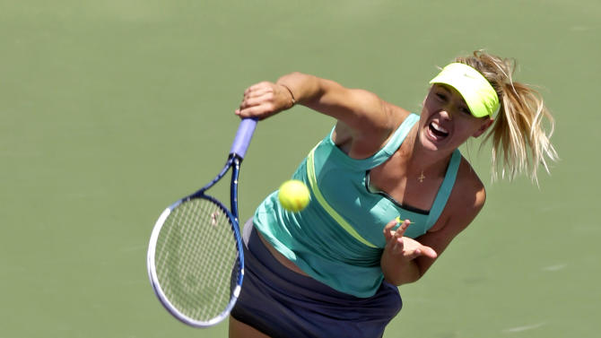 Maria Sharapova, of Russia, serves to Serena Williams during the final match of the Sony Open tennis tournament, Saturday, March 30, 2013, in Key Biscayne, Fla. (AP Photo/Wilfredo Lee)