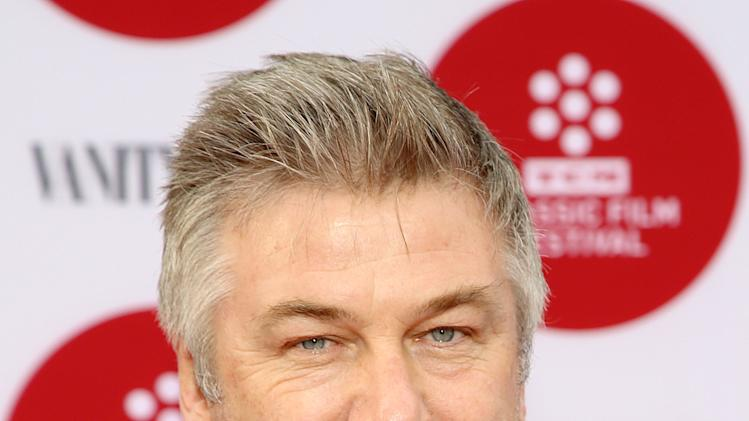"FILE - In this April 10, 2014 file photo, Alec Baldwin arrives 2014 TCM Classic Film Festival's Opening Night Gala at the TCL Chinese Theatre in Los Angeles. Canadian actress Genevieve Sabourin was convicted in November 2013 of stalking Baldwin with emails, phone calls, and unsolicited visits to his Manhattan apartment. Sabourian and Baldwin met in 2000 on a movie set and had dinner a decade later, and the actress said Baldwin made promises of a life together. The judge who sentenced her said no matter what happened between the two, Sabourin had no right to pursue contact she knew to be unwanted and amounted to a ""relentless and escalating campaign of threats and in-person appearances."" (Photo by Annie I. Bang /Invision/AP, file)"