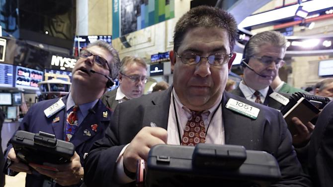 Trader Robert Oswald, foreground center, works on the floor of the New York Stock Exchange Wednesday, April 10, 2013. Stocks are opening higher on Wall Street, a day after the Dow Jones industrial average closed at its second all-time high in a week. (AP Photo/Richard Drew)