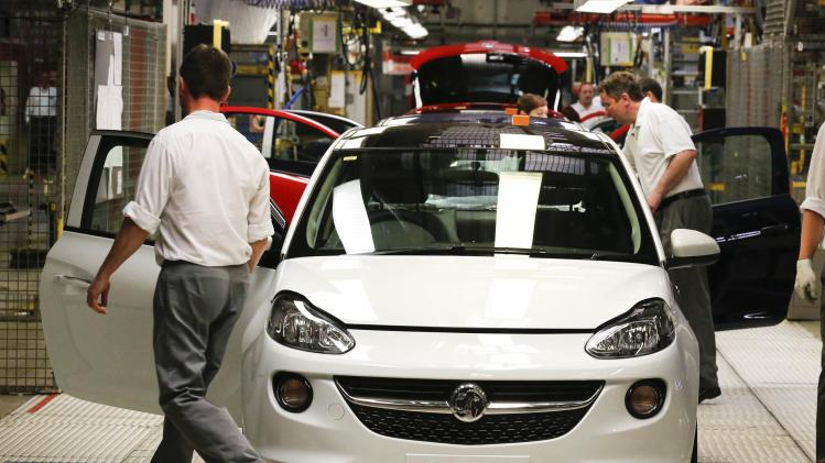 Employees work at the production line on an Opel Adam car at the Adam Opel AG plant in Eisenach