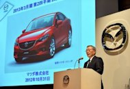 President of Japanese automaker Mazda, Takashi Yamanouchi, speaks to the media as he announces the company's first half financial results in Tokyo on October 31, 2012. Mazda on Wednesday said it had returned to profitability but reduced its annual sales forecast, blaming a Tokyo-Beijing territorial spat that has sparked a boycott of many Japanese exports