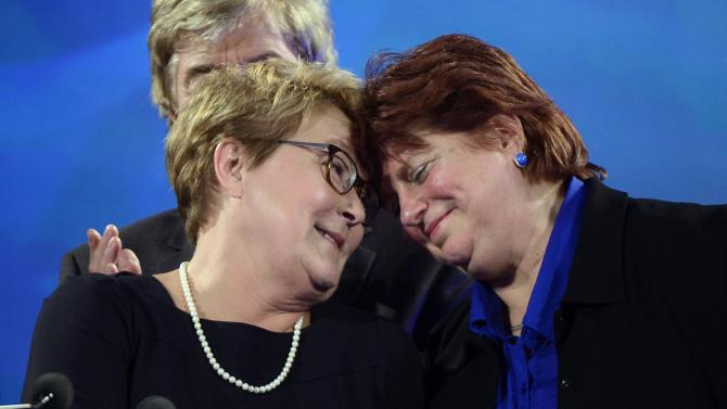 Parti Quebecois leader Pauline Marois is hugged by Nicole Leger after taking the stage following the PQ defeat in the provincial election Monday April 7, 2014 in Montreal. Marois also lost her seat in Charlevoix-Cote-de-Beaupre to Liberal candidate Caroline Simard. (AP Photo/The Canadian Press, Paul Chiasson)