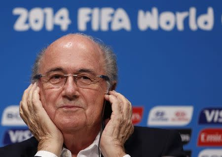 FIFA President Sepp Blatter attends a news conference at the Maracana stadium in Rio de Janeiro