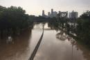 Flood waters cover Memorial Drive along Buffalo Bayou in Houston