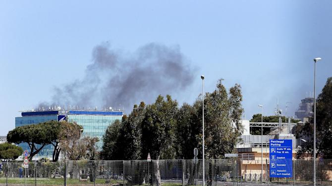 Smoke raises from a building near Terminal 3 at the international Fiumicino airport in Rome