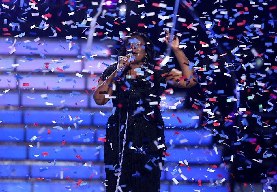 "Candice Glover performs on stage after she was announced the winner at the ""American Idol"" finale at the Nokia Theatre at L.A. Live on Thursday, May 16, 2013, in Los Angeles. (Photo by Matt Sayles/Invision/AP)"