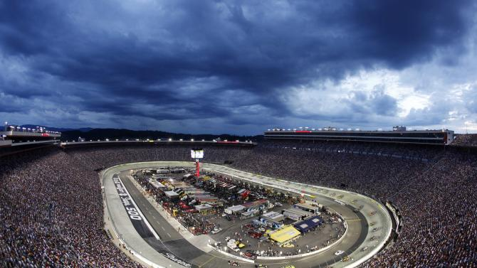 FILE - In this Aug. 22, 2009, file photo, the NASCAR Sprint Cup Series Sharpie 500 auto race is run under the lights at Bristol Motor Speedway in Bristol, Tenn. A person with knowledge of the plans tells The Associated Press on Wednesday, Oct. 9, 2013, that Tennessee and Virginia Tech will play an NCAA college football game at the speedway in September 2016. The person spoke on condition of anonymity because an official announcement is still in the works. The speedway holds 150,000. The attendance record for college football is 115,109, set last month at Michigan Stadium for the Michigan-Notre Dame game. (AP Photo/Mark Humphrey, File)