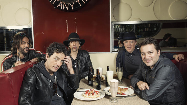 "This Oct. 1, 2012 photo shows members of The Wallflowers, from left, Rami Jaffee, Jakob Dylan, Stuart Mathis, Jack Irons and Greg Richling posing for a portrait at The Meatpacking Diner in New York. The Wallflowers released a new album this month titled, ""Glad All Over."" (Photo by Victoria Will/Invision/AP Images)"