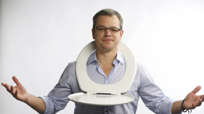 IMAGE DISTRIBUTED FOR WATER.ORG - Water.org's Matt Damon poses with a toilet seat in protest of the 2.5 billion people who don't have access to safe water and sanitation, and asks for help at http://strikewithme.org as of Tuesday, Feb. 12, 2013 in Los Angeles. (Photo by Todd Williamson/Invision for Water.org/AP Images)