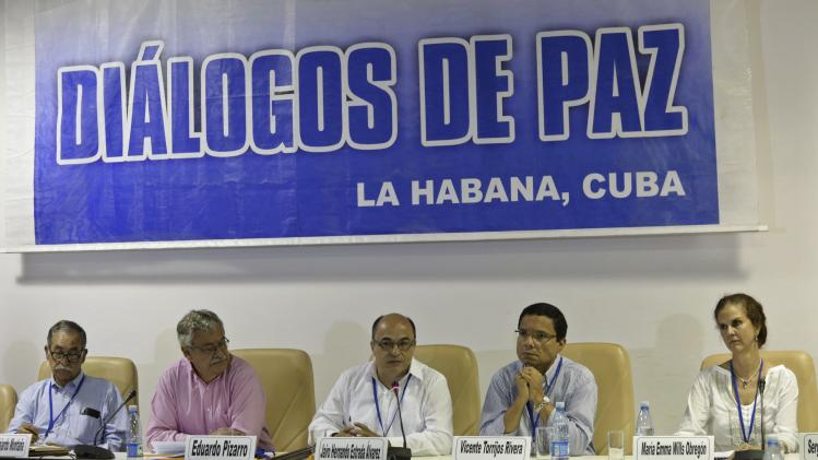 A peace committee installed by the government of Colombia and FARC attends a conference in Havana